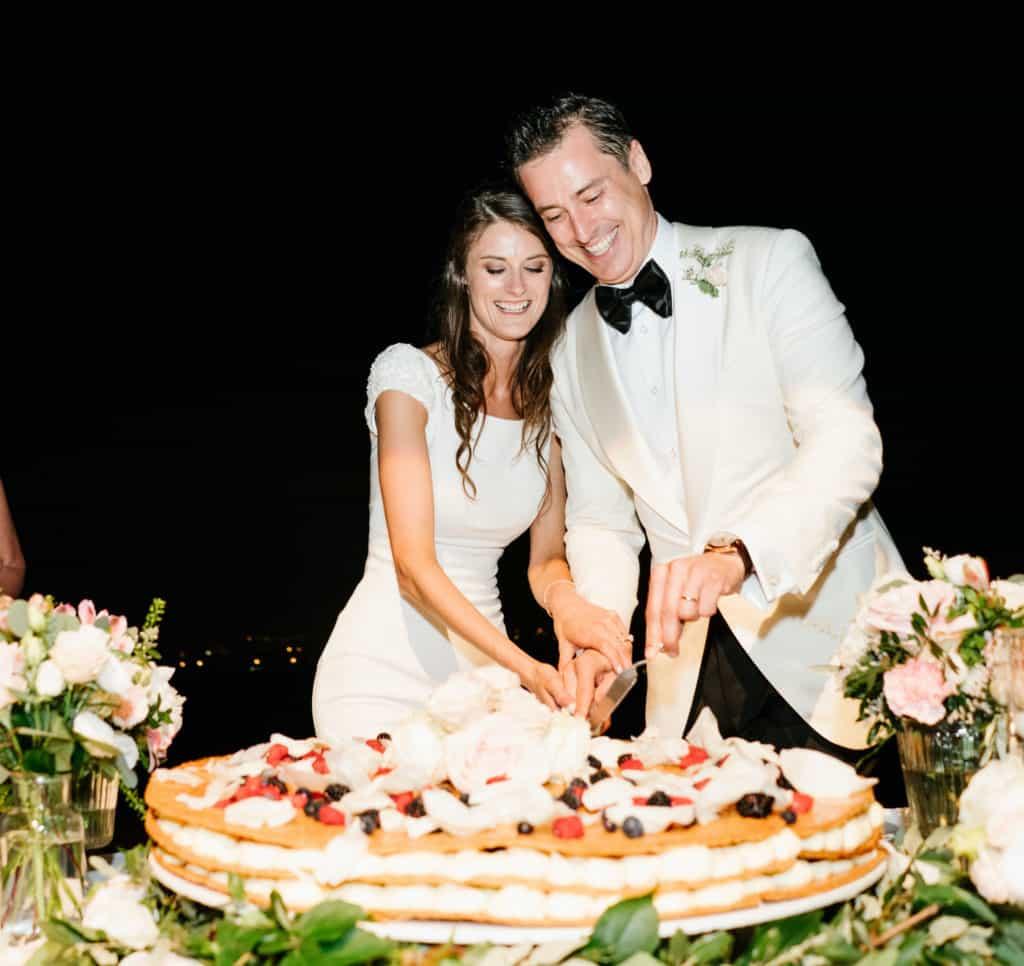 bride and groom with traditional Italian wedding cake