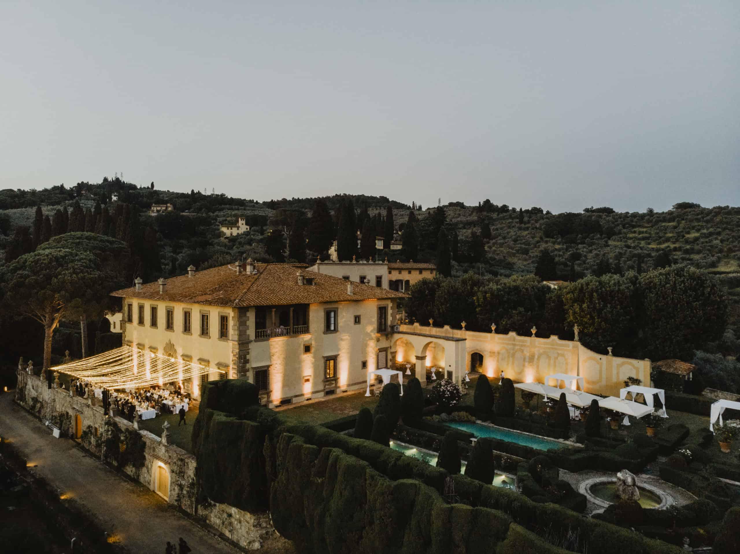 Villa Gamberia and grounds at dusk