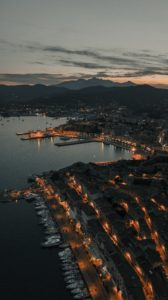 Aerial view over the Italian coastline at night.