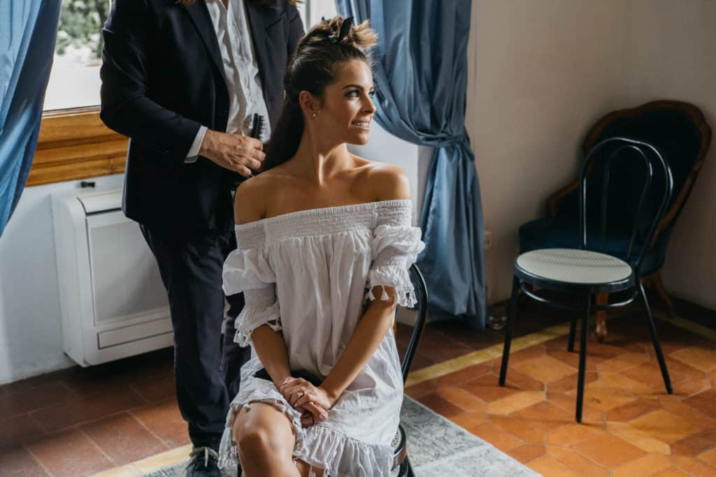 Beach Wedding in Italy -Bride getting ready with hair updo
